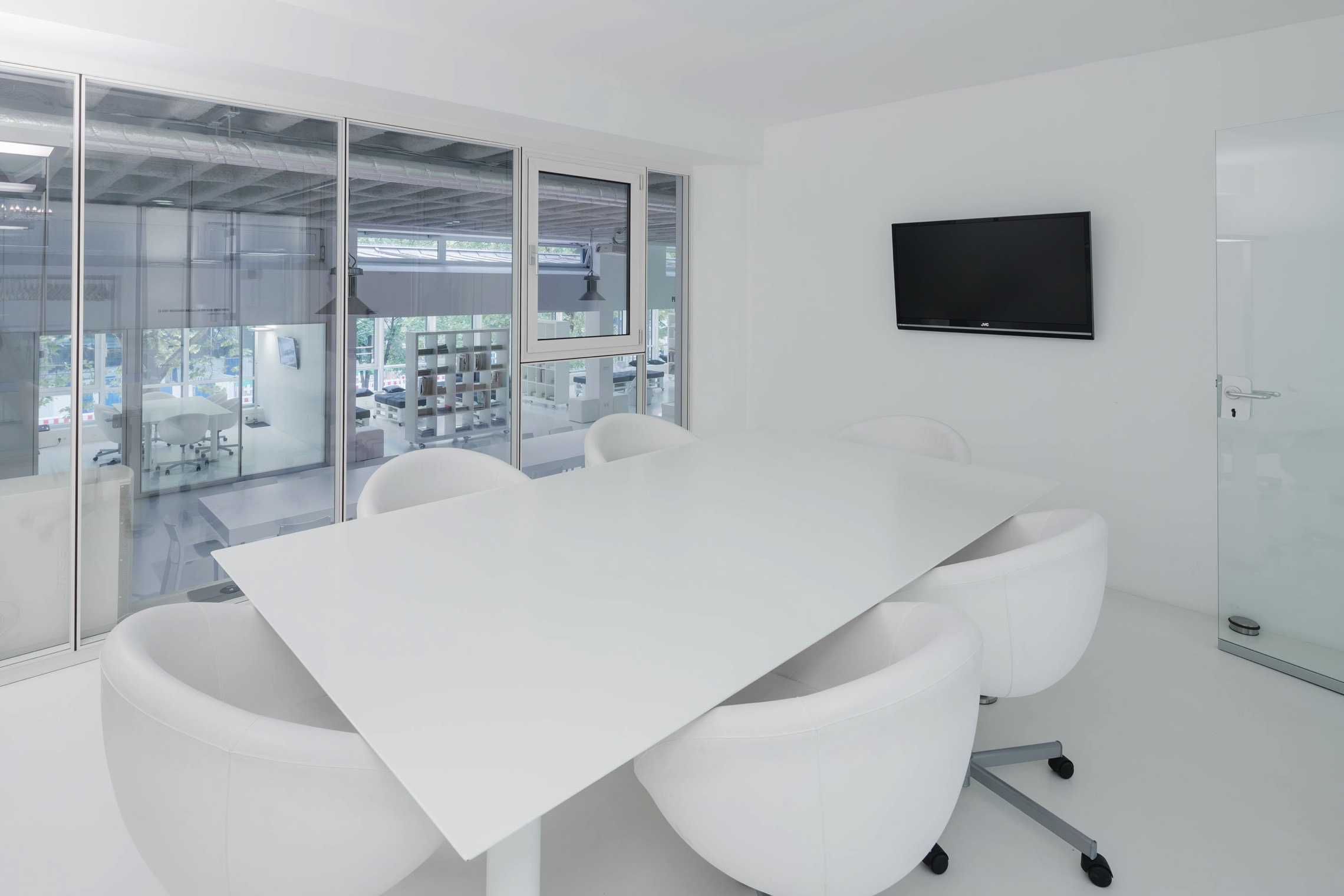 The Open Interior Design Promotes Productivity And A Glass Wall Allows A  View Over The Urban Offices.